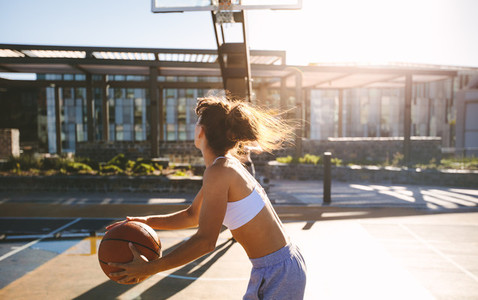 Woman playing streetbasket
