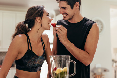 Healthy young couple in kitchen