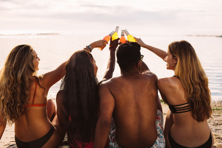 Friends having a party at the beach