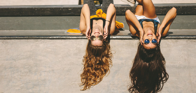 Female friends at skate park on a summer day
