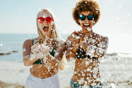 Best friends having fun on beach holiday