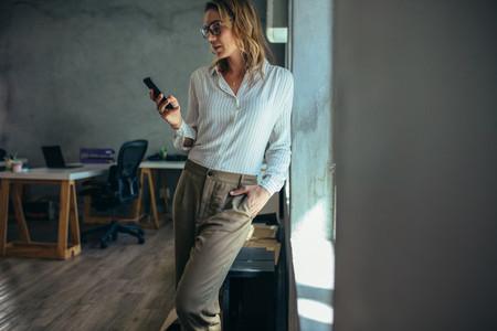Female entrepreneur using mobile phone