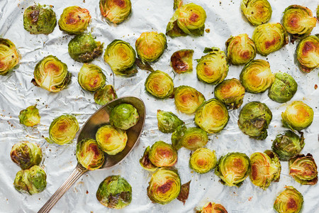 Top view of roasted brussel sprouts on a foil  The concept of healthy vegetarian eating