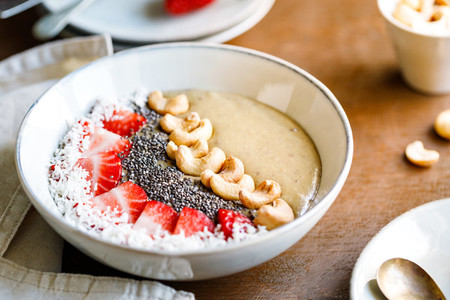 Smoothie bowl with banana matcha coconut cream strawberry cashew and chia seeds Healthy vegan eating