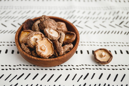 Chinese dried mushrooms Shiitake in a wooden bowl on a table  The concept of medicinal superfoods for health