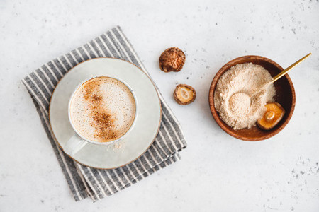 Top view of mushroom latte with Shiitake powder and unsweetened coconut almond blend milk Healthy useful vegan drink flat lay