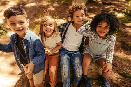Children having fun in forest