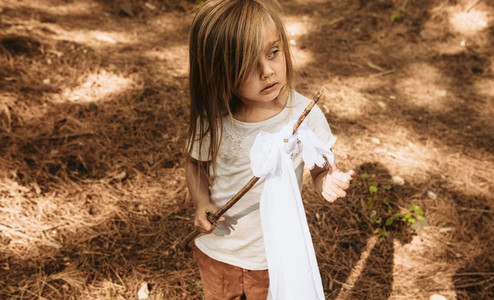 Child playing in forest