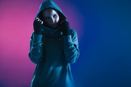 Fitness girl in hooded shirt