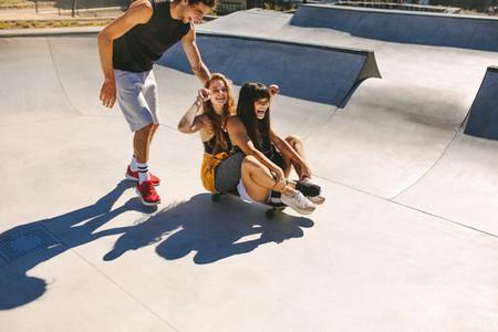 Group of friends having fun at skate park
