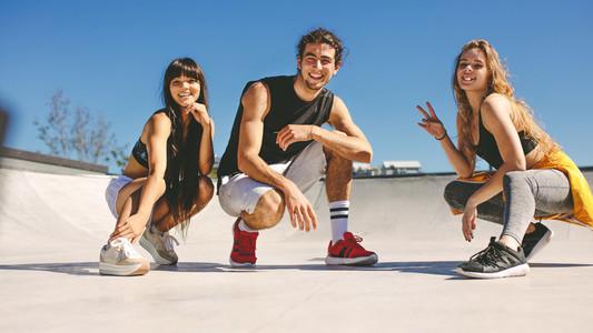 Friends at urban skate park