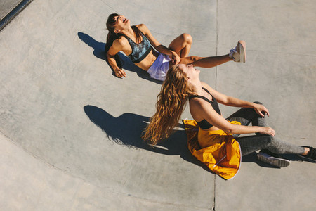Smiling girls hanging out at skate park