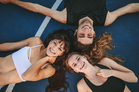 Friends relaxing on a basketball court