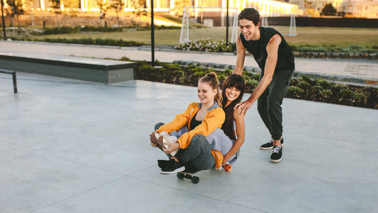 Friends having a great time at skate park