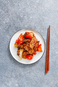 Szechuan traditional dish Hui Guo Rou  spicy roasted pork with leek and bell pepper  Portion size  top view