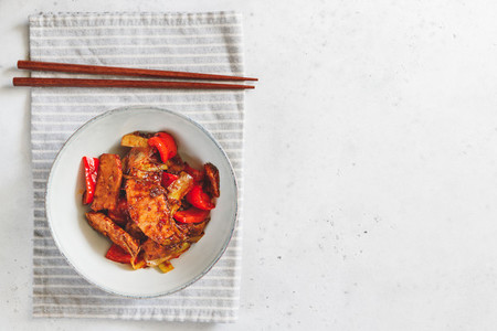 Szechuan traditional dish Hui Guo Rou  spicy roasted pork with leek and bell pepper  Served dinner for one person  top view  copy space