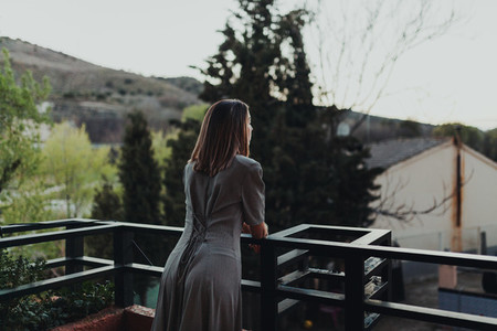 Young woman watch the sunset from their balcony