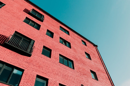 View from below on a pink modern house and sky  Vintage pastel colors  minimalist concept