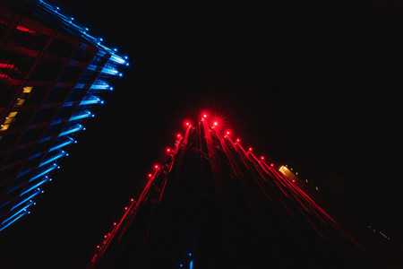 Low angle view of silhouettes skyscrapers  Night red and blue lights