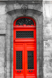 Old medieval red door is decorated cast iron forging ornament in Paris