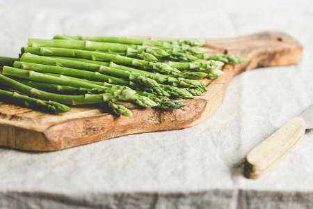 Fresh asparagus on a wooden cutting board  Preparation vegetarian healthy food