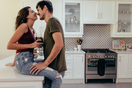 Couple romancing in kitchen