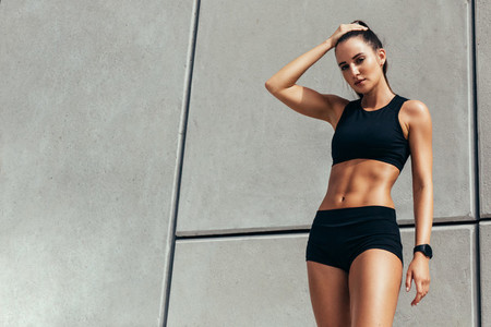 Female athlete feeling tired after workout