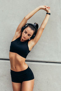 Beautiful sporty girl stretching