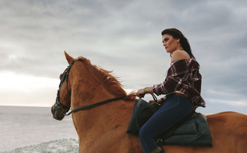 Woman riding a horse outdoors