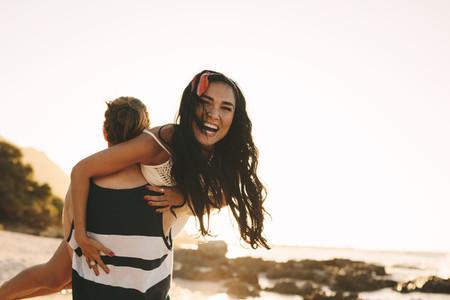 Tourist couple having fun at the beach
