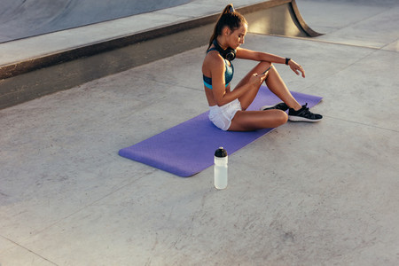 Female monitoring her fitness progress