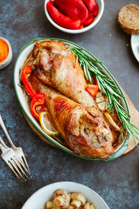 Festive dish for Thanksgiving  roasted turkey legs with vegetables on a table with snacks