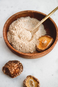 Rowder is made from Chinese dried mushrooms Shiitake in a wooden bowl on a table  The concept of medicinal additive for healthy food