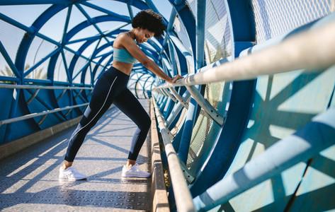 Runner doing stretching exercises