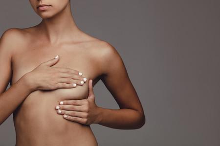 Girl examining her breast