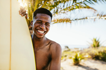 Smiling young surfer