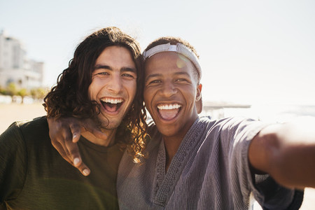 Cheerful friends making a selfie outdoors