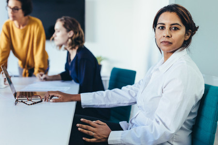 Female executive in conference room