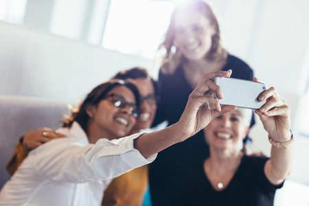 Group of business women taking selfie