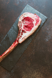 Top view of raw dry aged marble beef steak Tomahawk  Flat lay  cooking concept