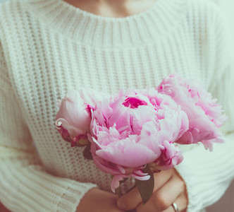 Girl holds beautiful bouquet pink peonies from  The concept of celebration and love