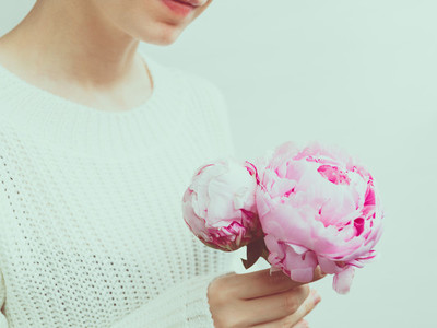 Girl holds beautiful bouquet pink from peonies The concept of celebration and love