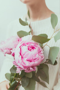 Girl holds beautiful bouquet from pink peonies  The concept of celebration and love