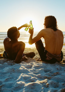 Friends partying in the beach with beers