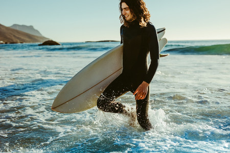 Surfer coming out of the sea
