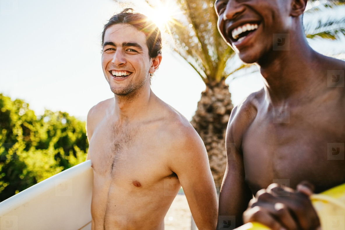 Friends going surfing on their holiday
