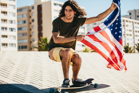 Man skateboarding with USA flag