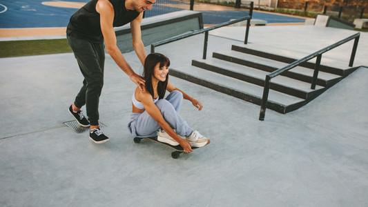 Young friends having fun at skate park