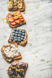 Vegan whole grain toasts with fruit  seeds  nuts