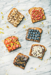 Vegan whole grain toasts with fruit seeds nuts top view